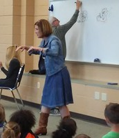 Students make story suggestions to Candace as Eric illustrates.
