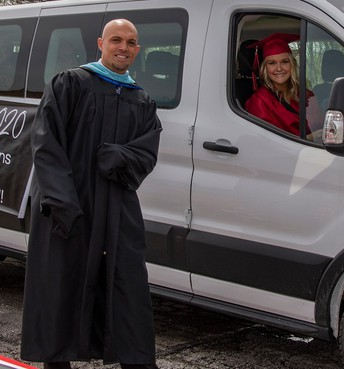 Mr. Murray and student at drive-through Commencement 2020 [photo credit:  G-TV]