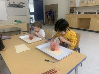Pathways students bubble painting Valentine's Day cards.