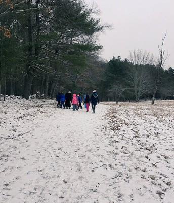Grade 1 explores the environment on their Big Backyard winter walk