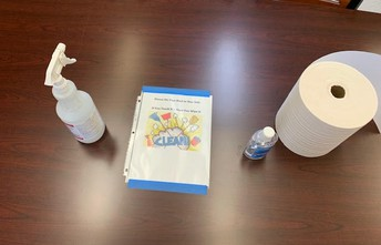 Staff table with sanitizer and reminder signage