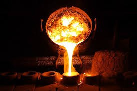 Molten metal pours into a mold