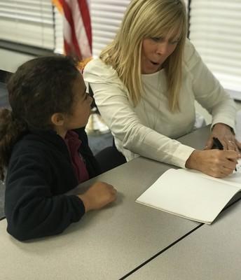 Renee Adams signing books