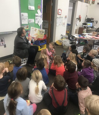 Mr. Gronseth reading to the Spanish K students