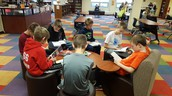 5th graders reading in the library