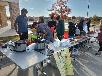 Students host a garage sale to raise money to purchase parts for the computer building project.