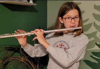 Alexis practices her flute!