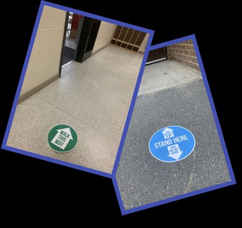 Signs are up on walls and floors to help give visual guidance to students and staff