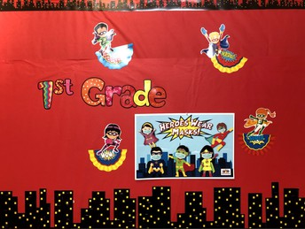 First Grade Bulletin Board with our masked superhero theme