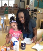 Taneisha cooking with the children.