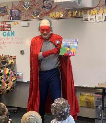 Captain 100 read a story about being 100 Days Smarter!