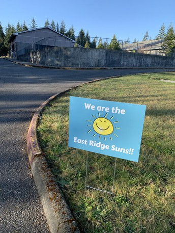 picture of 'We are the East Ridge Suns!!' yard sign on lawn