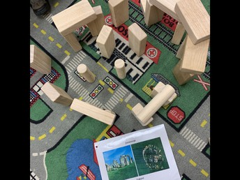 "Mrs. Rebstock's class was studying ""Buildings"" students worked to create the Seven Wonders of the World in the blocks center."