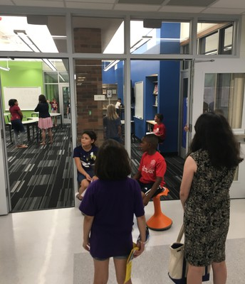 Families Learning About New Spaces From Our Lions