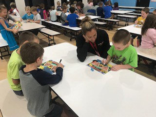 Mrs. DeLuca playing math games with students