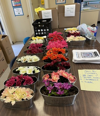 Our office Manager Carie Wade creates flower arrangements for all Welcoming tables for each classroom!