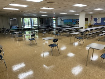 Our cafeteria has both tables and desks to allow for over 6 ft distancing while eating