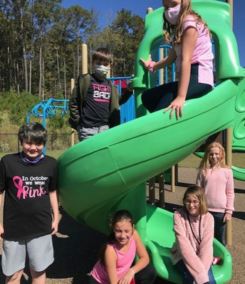 students in pink on playground