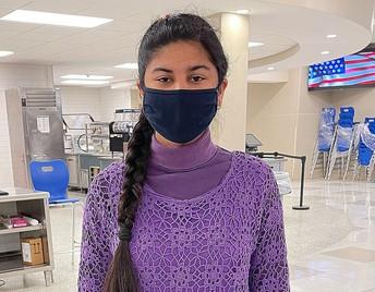 Student dressed in purple