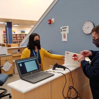 Mrs. Van Leer shows how to process books