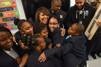 Detective Busby from Boston Police School Unit group hug!