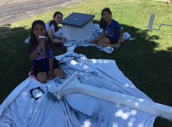 Nina, Elisa and Leidy work hard painting our new Little Free Library