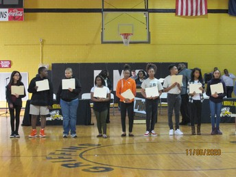 Students in line with Quarter 1 Honor Roll Certificates