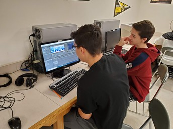 Students working on editing video clips in Media Arts.