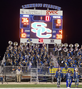 image of scoreboard at homecoming game announcing final score of 36-0, buffs