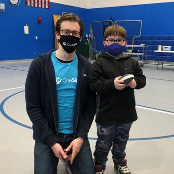 OneSight representative with Reading Student wearing new glasses