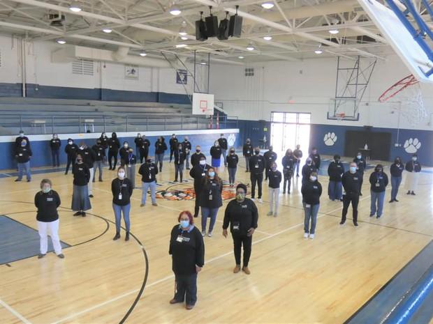 Dillard Middle School staff in gym