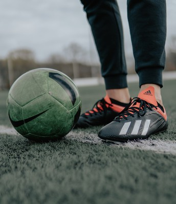 photo of soccer ball and cleats