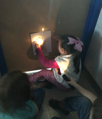 Kinder Students Experimenting with Light and Shadows