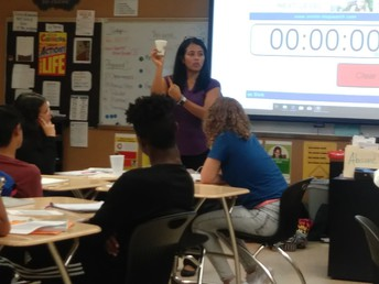 Ms. La Terra at Treasure Coast High School facilitating a School Connect Lesson where students learned about prioritizing using rocks and rice.