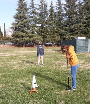 Emily prepping her Rocket for launch.