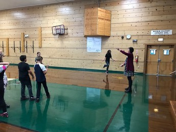 Ms. Tantardino showing students in PE how to jump rope, even double dutch!