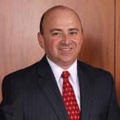 Ramon Garza, Trustee