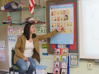 Miss Sarah Gatto reviews the alphabet with Tiny Toppers Preschool students.