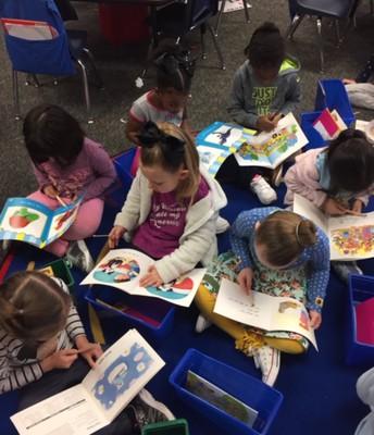 Kindergarteners practicing independent reading strategies
