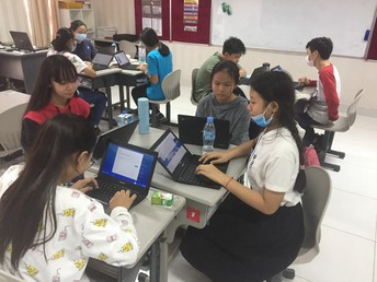 Grade 8 students researching on viral diseases
