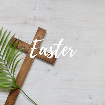A wood cross with a palm leaf