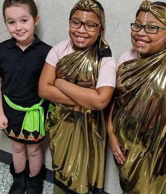 The McGee Bradberry's wear African attire. Irelyn Daupert wears Irish garb.