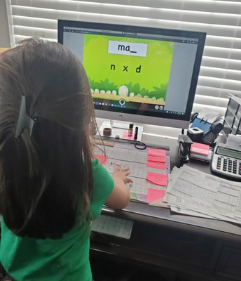 Milly working at home on My Lexia