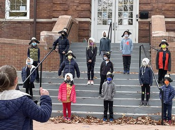 Old Greenwich students perform during a school play