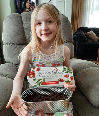 "This ""berry sweet"" girl is planting strawberries. Way to extend your plant unit!"