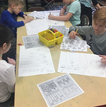 "3rd grade working hard on their ""James Rizzi Cityscapes"""