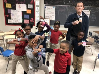 Exploration Academy students create bracelets for the Year of the Rat with Mr. Cheng during their Chinese lesson