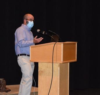 Mr. Doug Finn speaking with teachers
