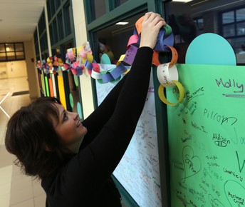 Mrs. Reichard hanging our Kindness Chain