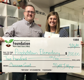 Matt Lillpop presents a Classroom Grant check to Kelly Ottens at Prophetstown Elementary